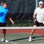Bob Bob Zinsmaste backhands ball with Mike Pascal in Men Doubles Pickleball Tournament 50+ Tampa Bay Senior Games 2013, Sun City Center, FL [DAY TWO: Saturday, October 26, 2013]backhands ball with Mike Pascal in Men Doubles PickleballTournament 50+ Tampa Bay Senior Games 2013, Sun City Center, FL [DAY TWO: Saturday, October 26, 2013]