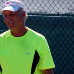 Competitor smiling in Mens Double Pickleball Tournament at Tampa Bay Senior Games 2013, Sun City Center