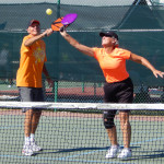 Couple ready to hit ball simultaneously in Mixed Doubles Pickleball Tournament 2013 Tampa Bay Senior Games, Sun City Center