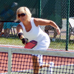Hitting ball over net in Womens Pickleball Tournament Tampa Bay Senior Games 2013 Sun City Center