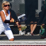 Hitting ball over net in Womens Pickleball Tournament Tampa Bay Senior Games 2013 Sun City Center FL