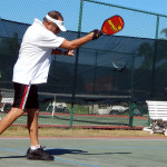 John Marinchek hitting ball in 75+ Mens Doubles Pickleball in Tampa Bay Senior Games, Sun City Center, FL [DAY ONE: Friday, October 25, 2013]