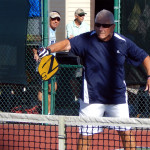 Man hits ball in Pickleball 70 + Doubles tournament at Tampa Bay Senior Games 2013, Sun City Center, Florida [DAY ONE: Friday, October 25, 2013]