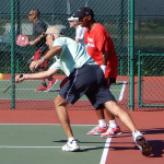 Man hits ball in ball 70 Plus Doubles Pickleball Tournament at Tampa Bay Senior Games 2013, Sun City Center, Florida [DAY ONE: Friday, October 25, 2013]