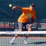 Man hitting ball in Pickleball Tournament 2013 Tampa Bay Senior Games, Sun City Center