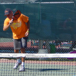 Man serving ball in Mixed Doubles Pickleball Tournament 2013 Tampa Bay Senior Games, Sun City Center
