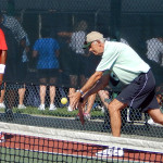 Man serving in Mens Doubles Pickleball Tournament Tampa Bay Senior Games 2013, Sun City Center
