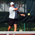 Mike Pascal hits ball in Men's Doubles PickleballTournament 50+ Tampa Bay Senior Games 2013, Sun City Center, FL [DAY TWO: Saturday, October 26, 2013]