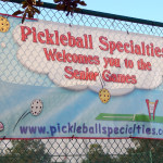 PICKLEBALL SPECIALTIES banner on fence at Tampa Bay Senior Games 2013 Sun City Center