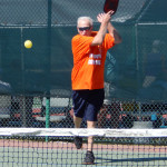 Player hitting ball in Mixed Doubles Pickleball Tournament 2013 Tampa Bay Senior Games, Sun City Center [DAY THREE: Sunday, October 27, 2013]