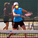 Women hitting ball in Womens Doubles Pickleball Tournament Tampa Bay Senior Games 2013, Sun City Center
